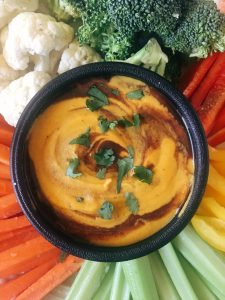 Vegan Chili Cheese Sauce with Vegetable Plate Close Up