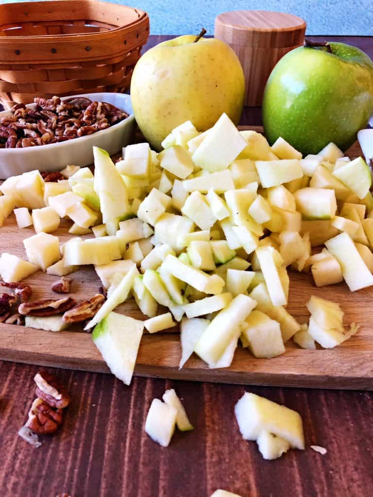 yellow and green chopped apples on cutting board