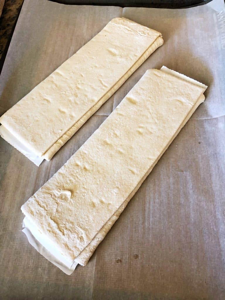 two sheets of puff pastry on parchment paper