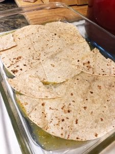 Tortillas layered in the pan for Mexican Casserole