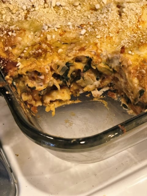 vegan lasagna in pan with piece cut out