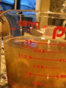 peanut butter and broth in a measuring cup