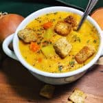 coconut curry butternut squash soup in a white soup bowl