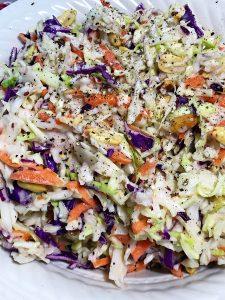 red wine vinegar coleslaw in white dish