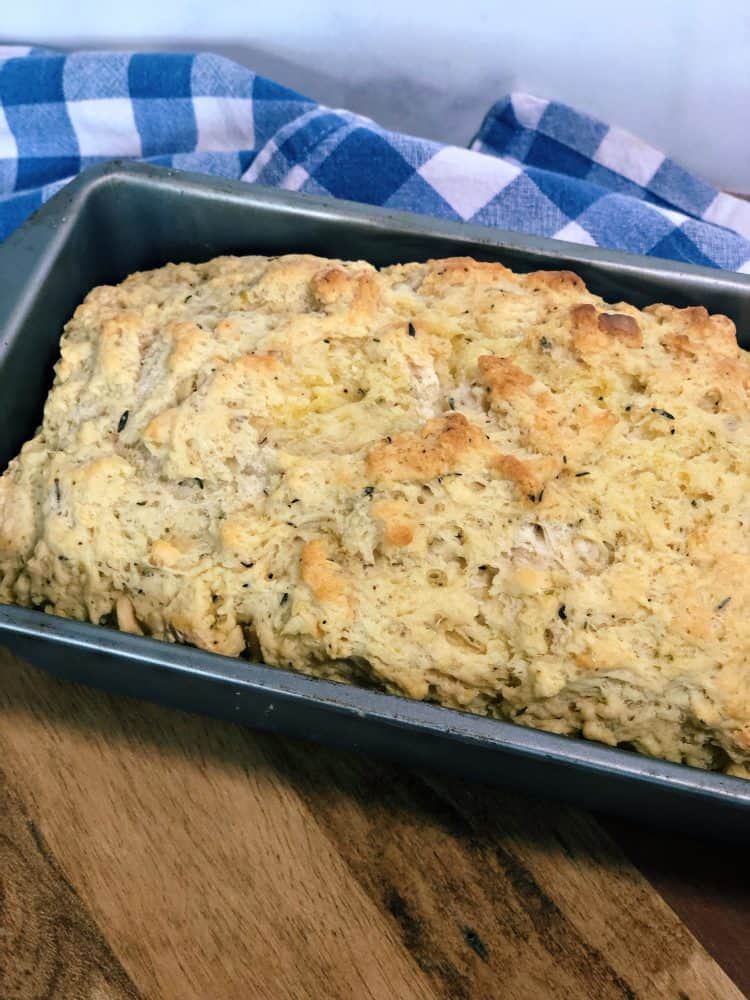 load of garlic herb beer bread with blue checkered napkin