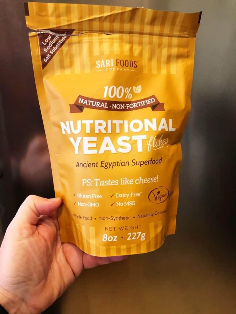 Sari brand nutritional yeast bag held in hand