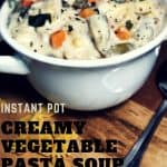 creamy vegetable bow time pasta soup in white bowl