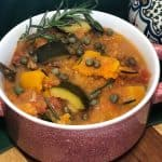 slow cooker butternut squash ratatouille in red bowl with green napkin