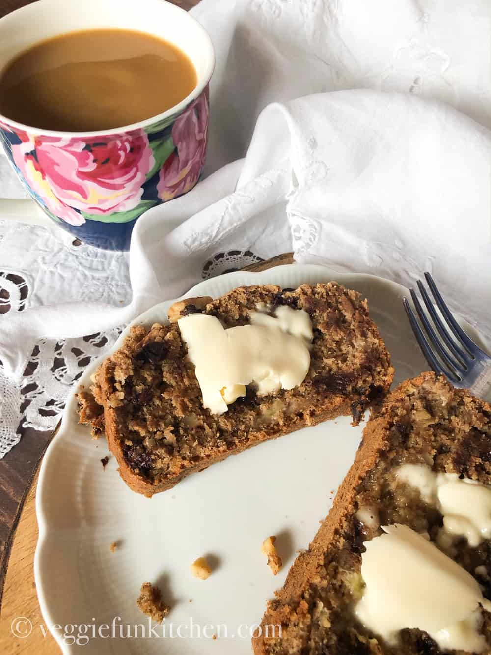 Chocolate Chip banana Nut bread on plate with coffee