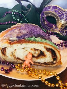 king cake with baby beads and mask