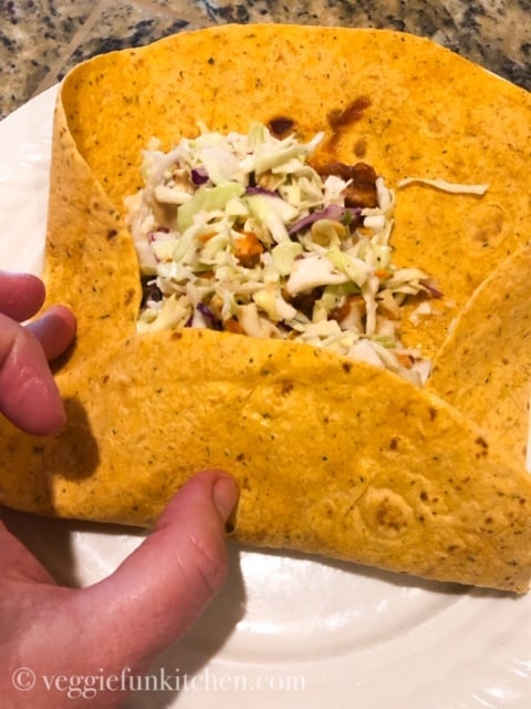 bbq crunch wrap with soy curls being rolled