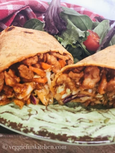 BBQ Crunch Wrap with soy curls on green plate with red checked napkin