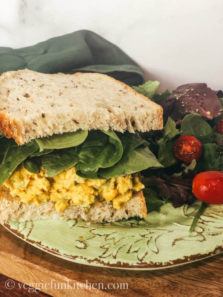 vegan egg salad sandwich on free plate with garden salad