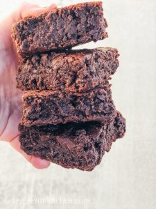 four brownies held in a hand