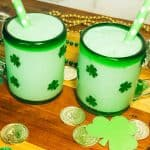 two shamrock shakes in glasses with green polkadot straws