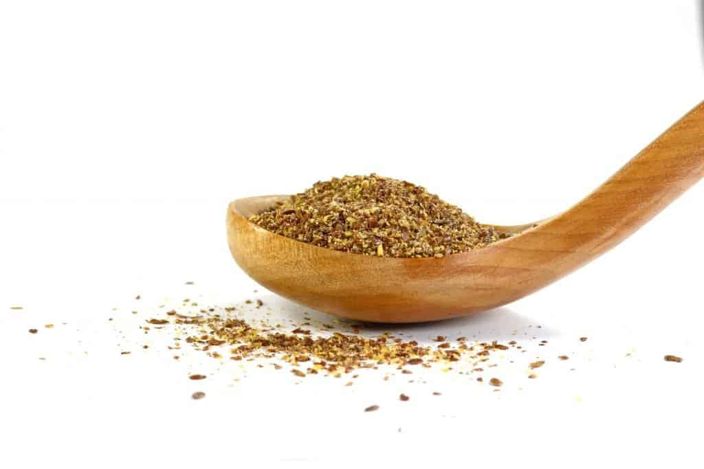 ground flax on a wooden spoon