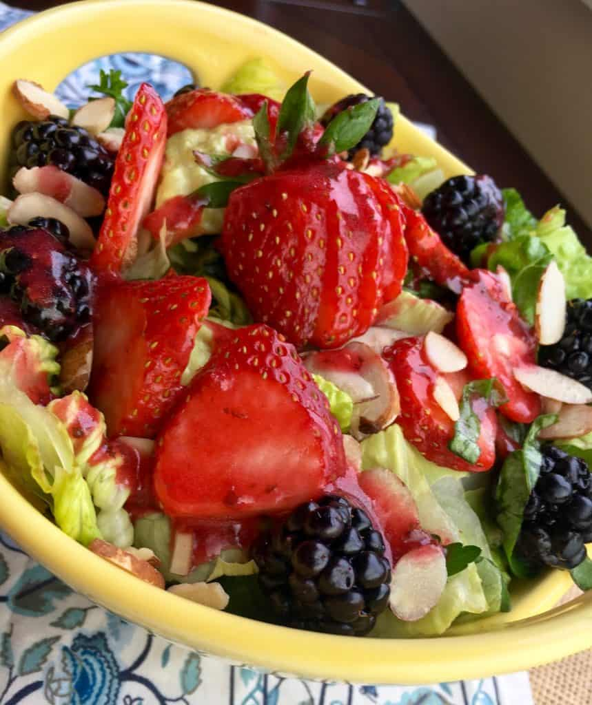 berry salad with almonds in yellow dish