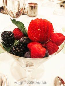 strawberries, blackberries, raspberries in a glass cup