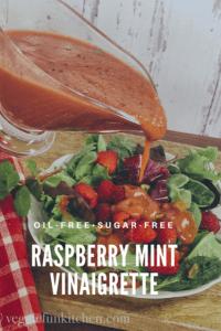 raspberry mint vinaigrette being poured onto berry salad
