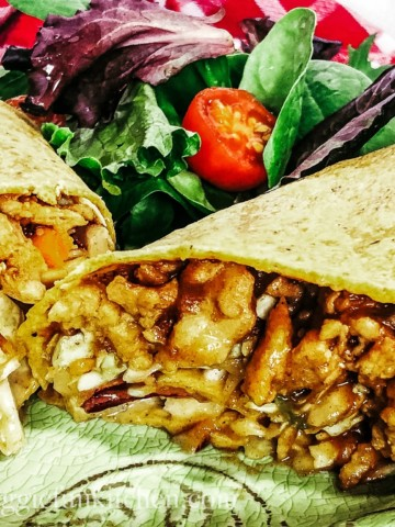 BBQ Crunch Wraps on green plate with salad in background