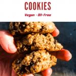 3 healthy oatmeal cookies held in hand