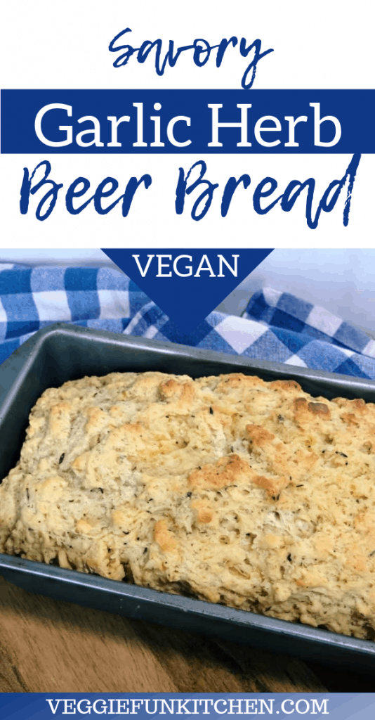 savory garlic herb beer bread in loaf pan on blue checkered cloth