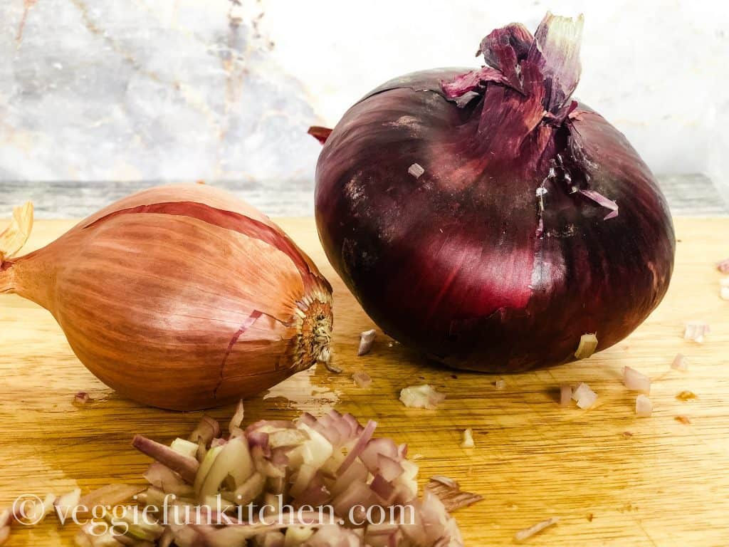 scallion and red onion on wooden cutting board