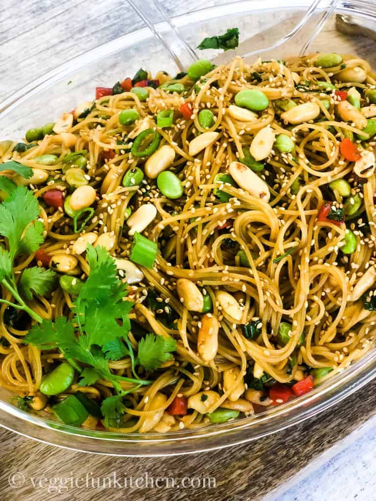asian pasta salad in clear bowl.