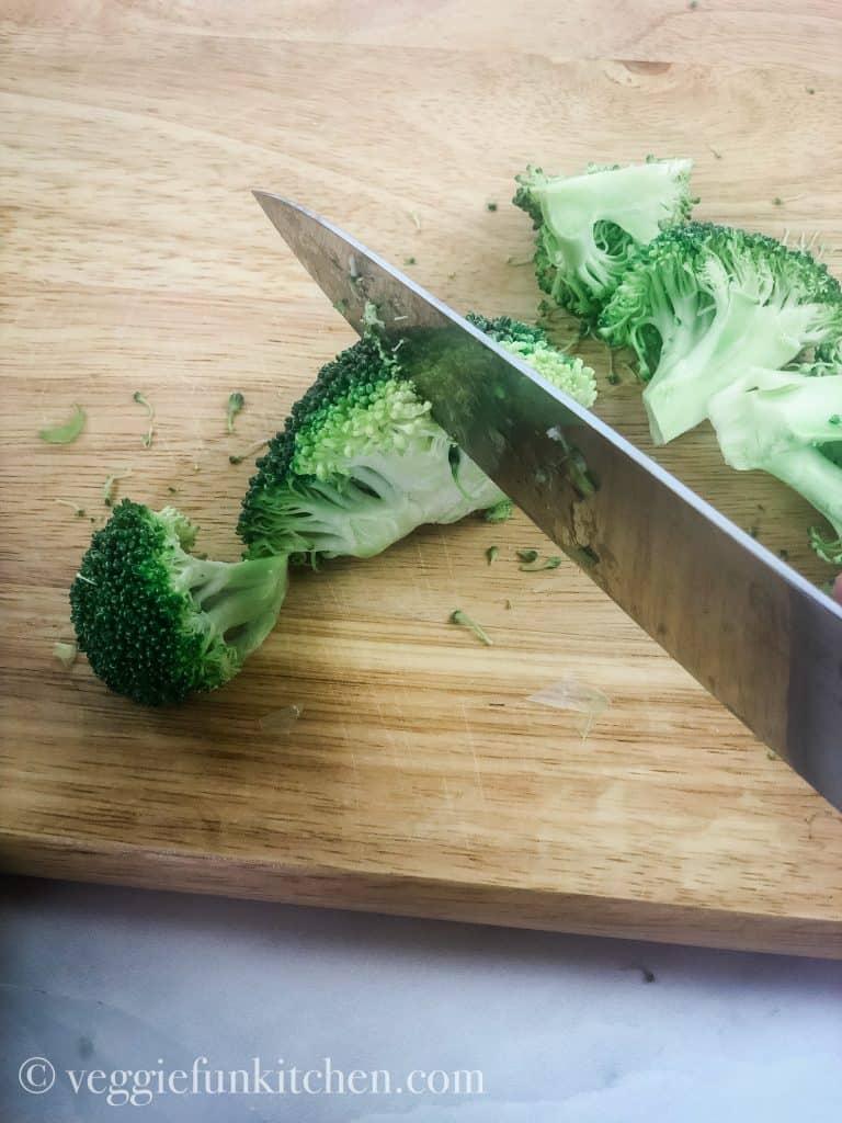 broccoli cut on board with knife