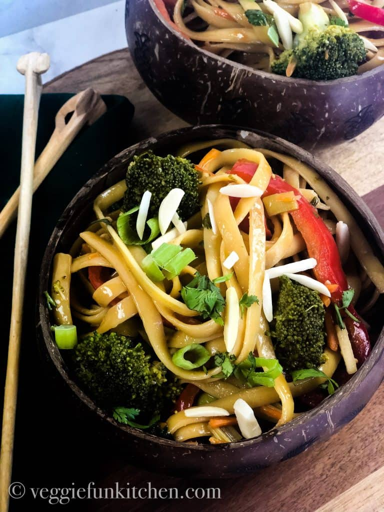 asian noodles in coconut bowls