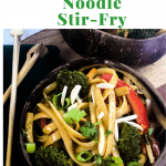 asian noodle stir -fry with vegetables in coconut bowls