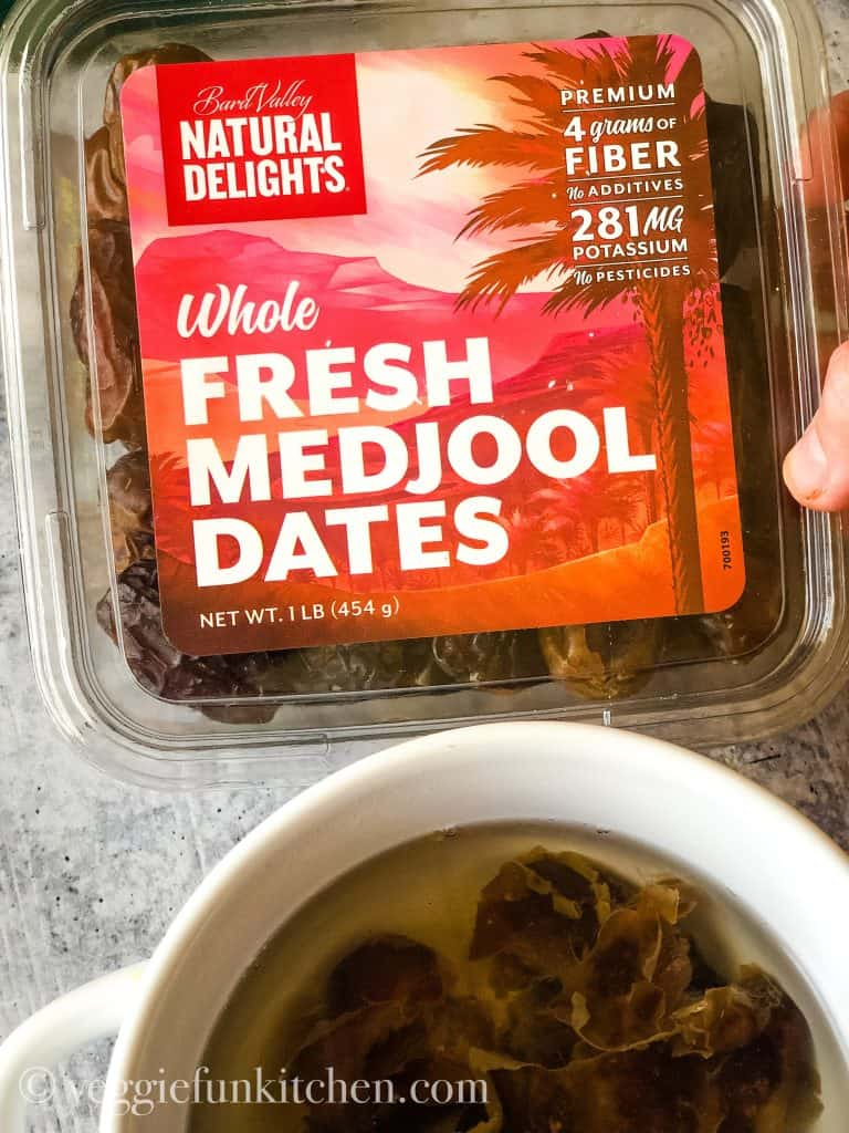 medjool dates in the package and soaking in a white bowl.