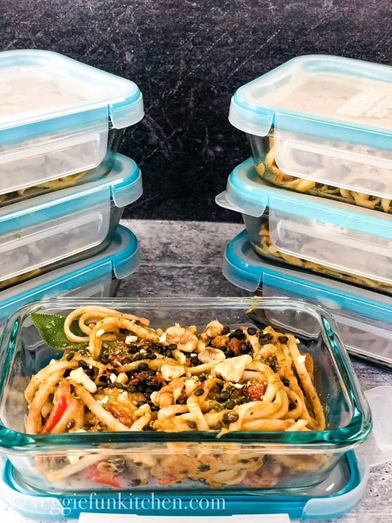 meal prep containers with pumpkin pasta
