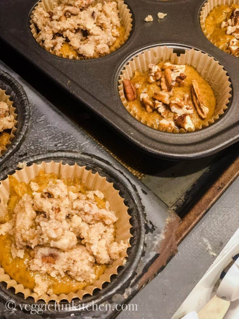 pumpkin muffins in the pan showing different topping options.