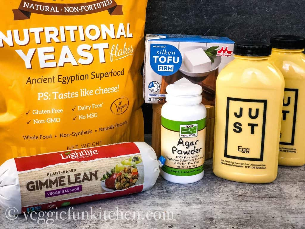 ingredients for breakfast casserole including vegan sausage. nutritional yeast,silken tofu, agar powder, just egg product