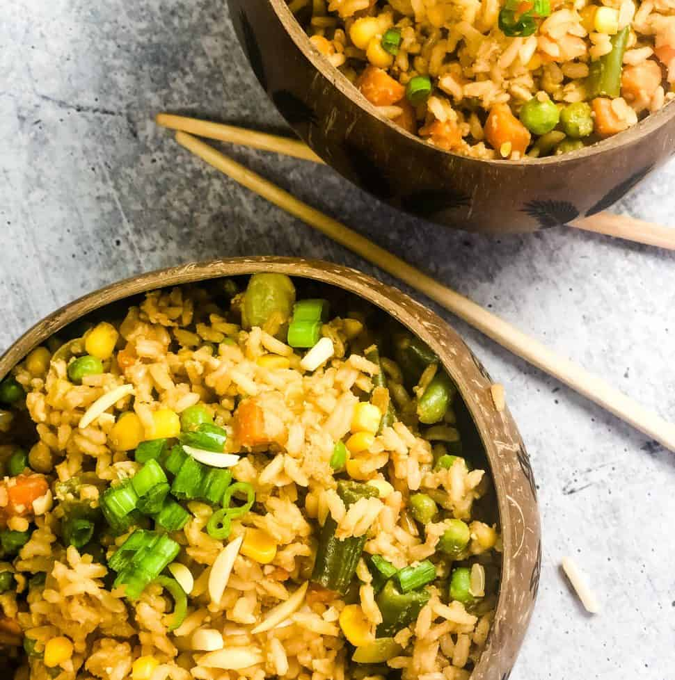 fried rice in two coconut bowls