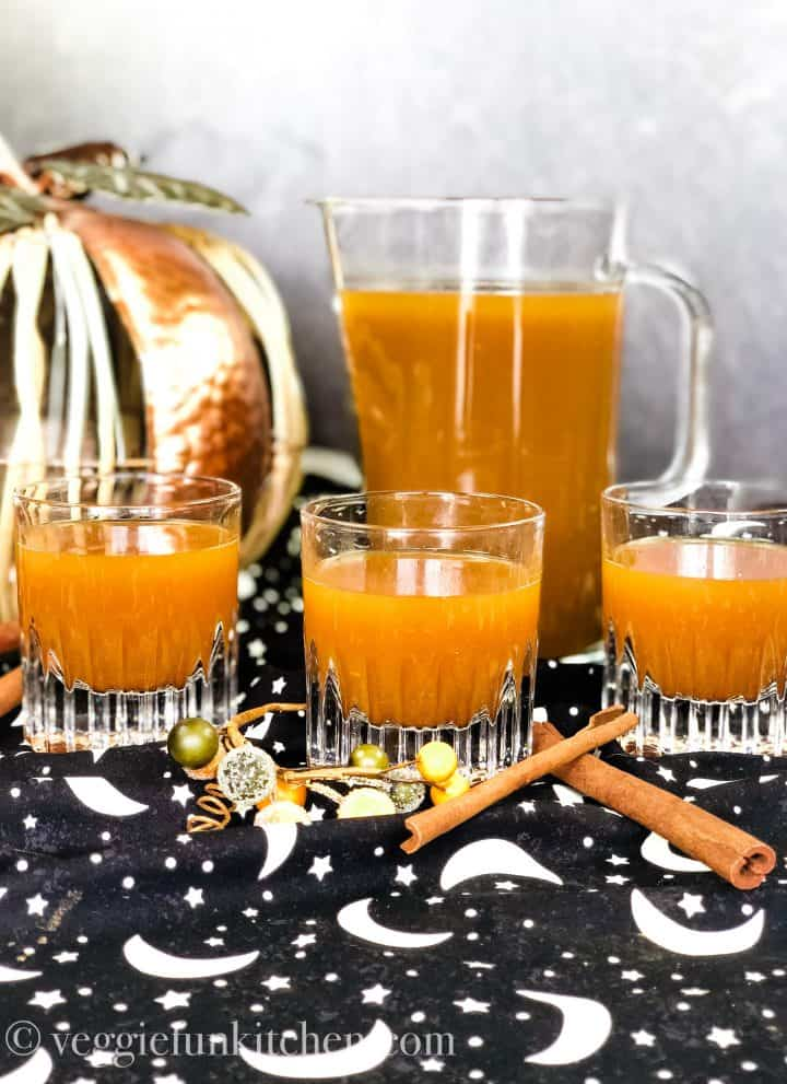 pumpkin drink in picture with three filled glasses