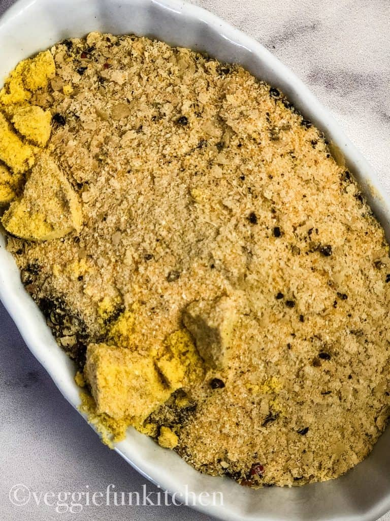 seasonings for vegan baked mac and cheese in a white bowl
