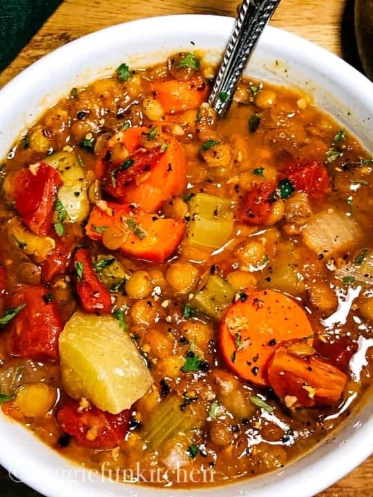 veggie lentil soup in white bowl