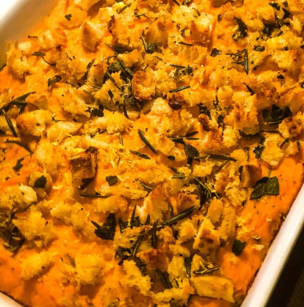 sweet potato casserole baked in white casserole dish