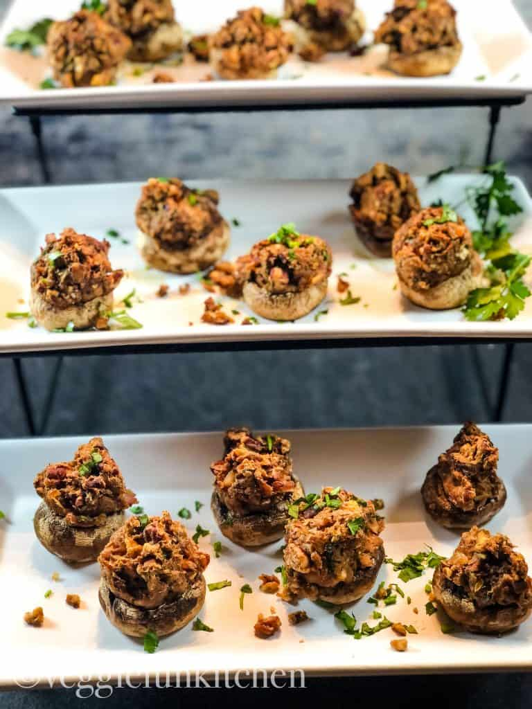 vegan stuffed mushrooms on three trays