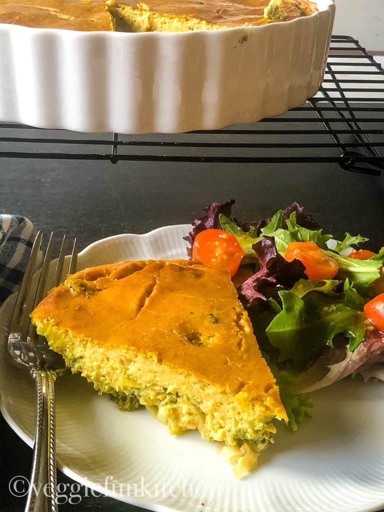 slice of broccoli leek frittata with salad and piece of frittata on fork