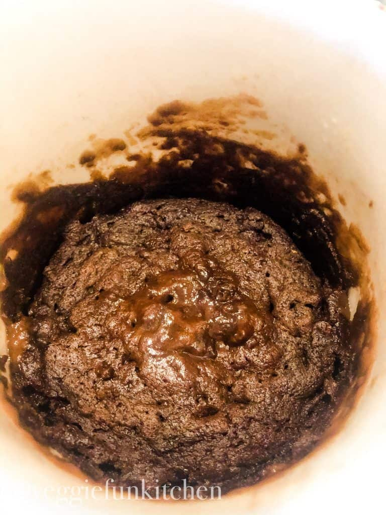 messy cup of cooked brownie. The sides of cup weren't wiped