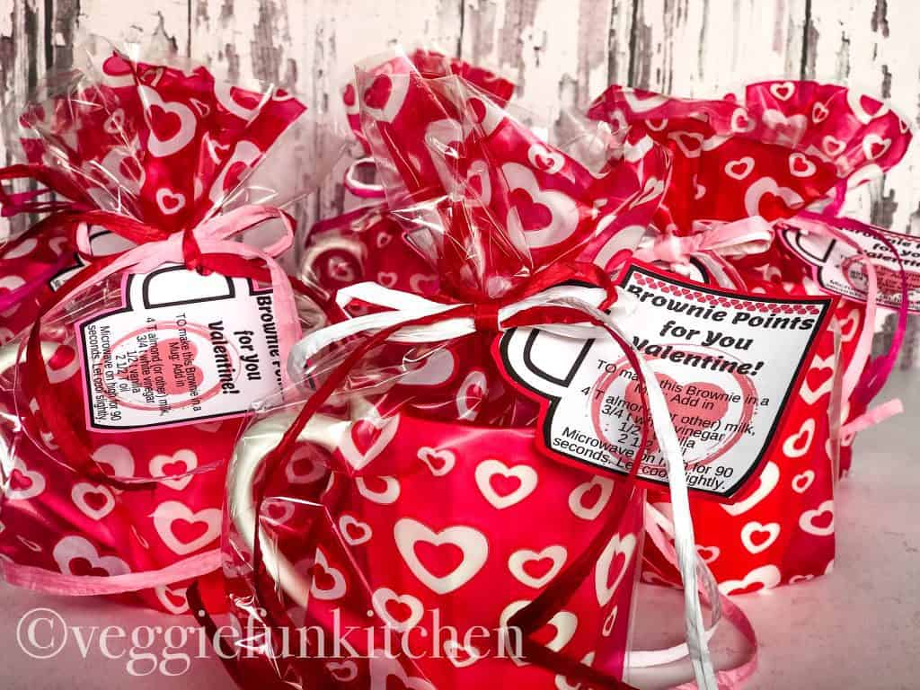 tied and finished mugs with cute red valentine wraps with hearts, directions on paper mug, tied with raffia ribbon