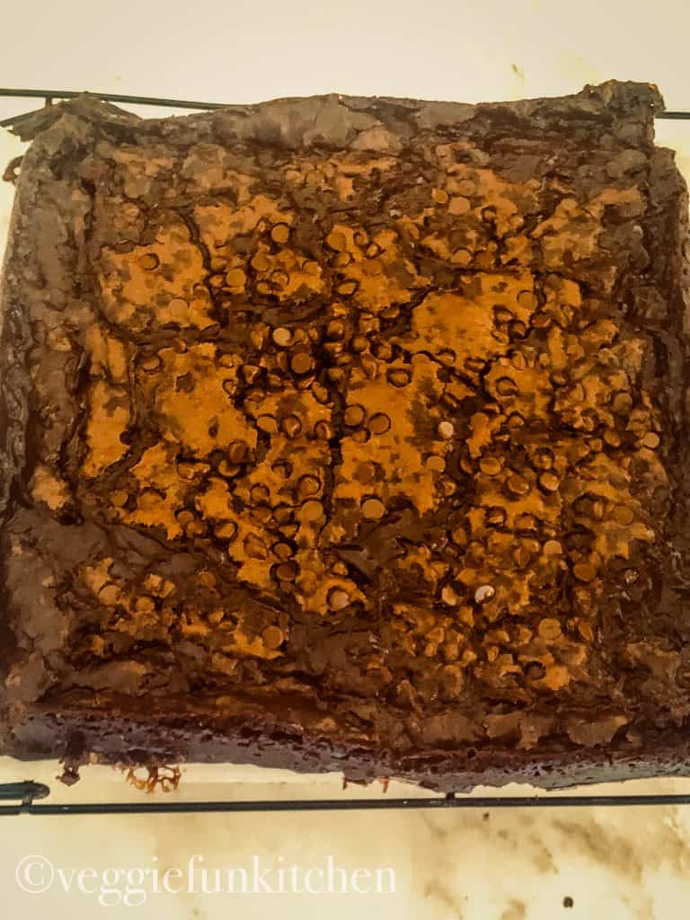 vegan fudge brownies cooling on rack