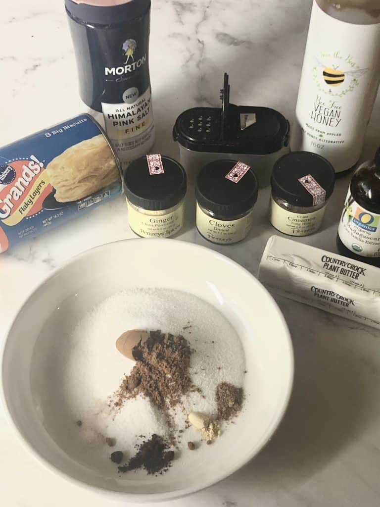 ingredients for monkey bread including biscuits, sugar, spices, vegan honey butter and vanilla