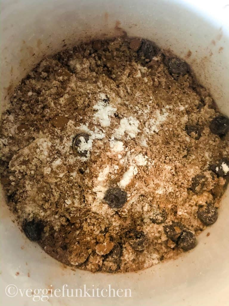 dry ingredients mixed in mug for vegan brownie.