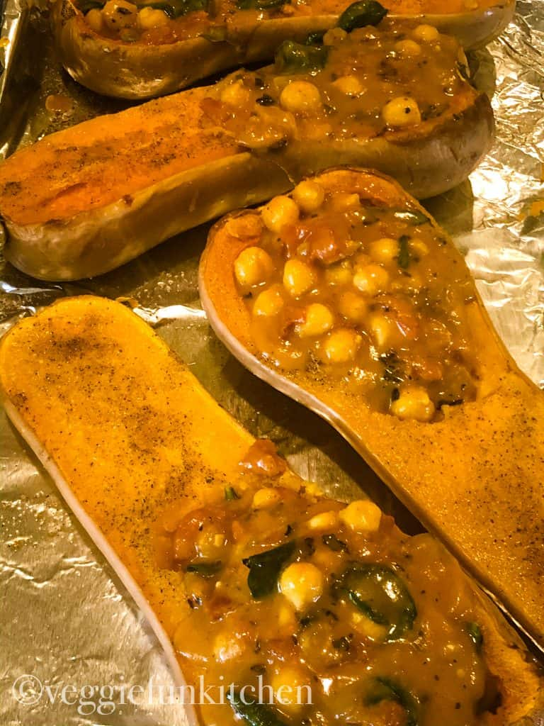 4 halves butternut squash half stuffed with curried chickpeas cooked