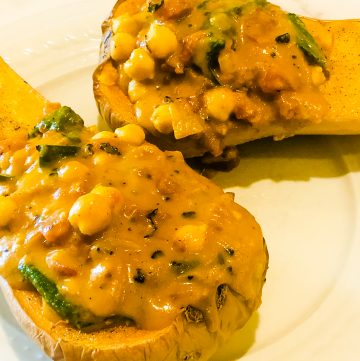 Twobutternut squash half stuffed with curried chickpeas cooked