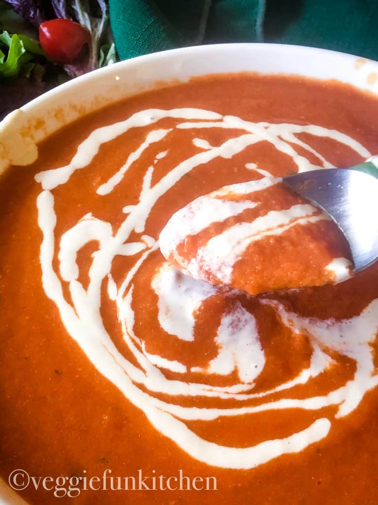 garlic sauce swirled onto tomato soup